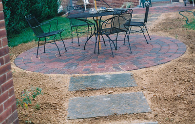 appian circle pattern paver patio with large bluestone slab walkway