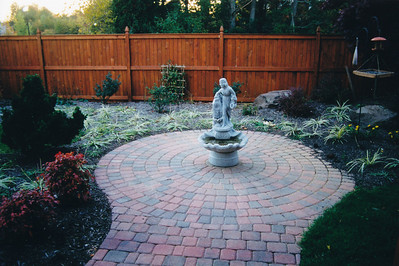 Appian circle pattern paver patio with cedar fencing