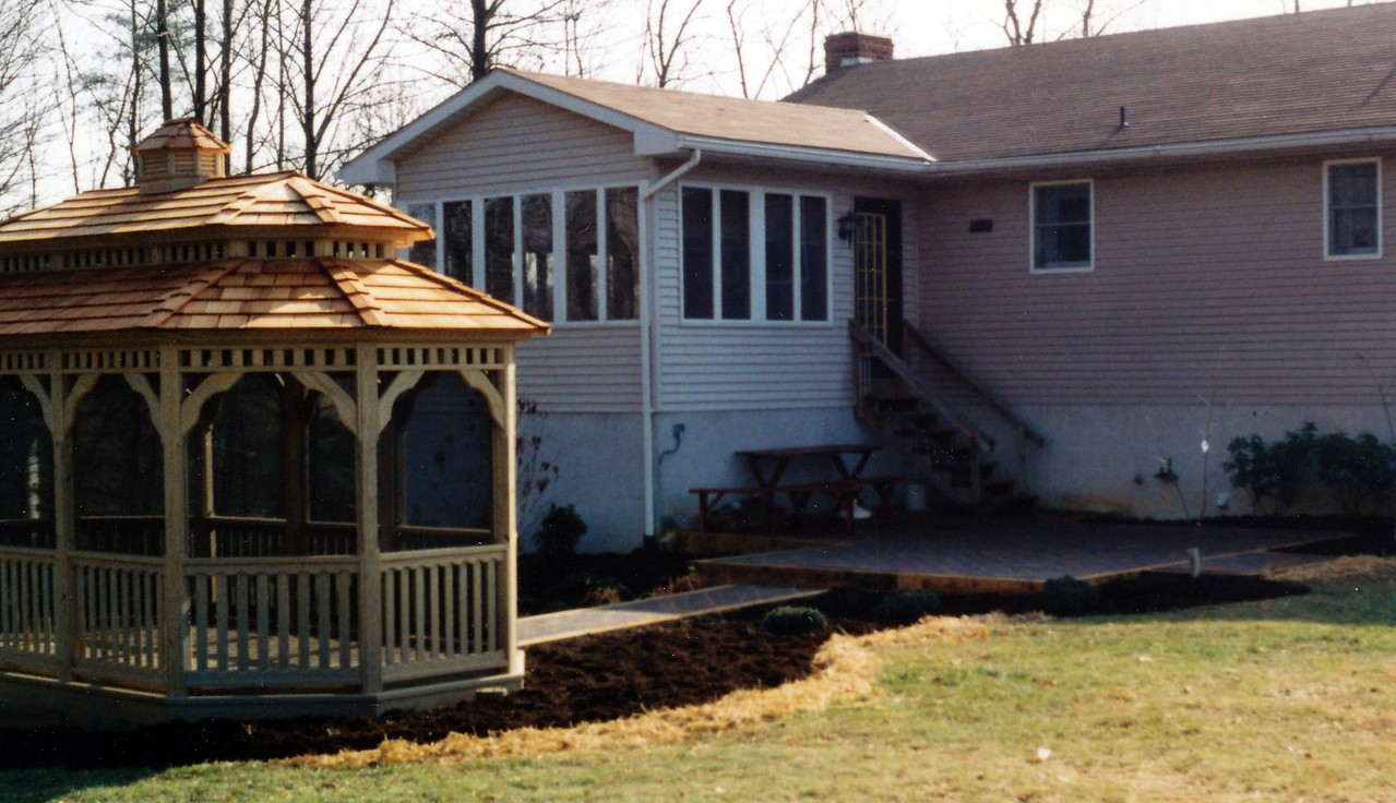 paver and timber patio and walkway leading to cedar gazebo