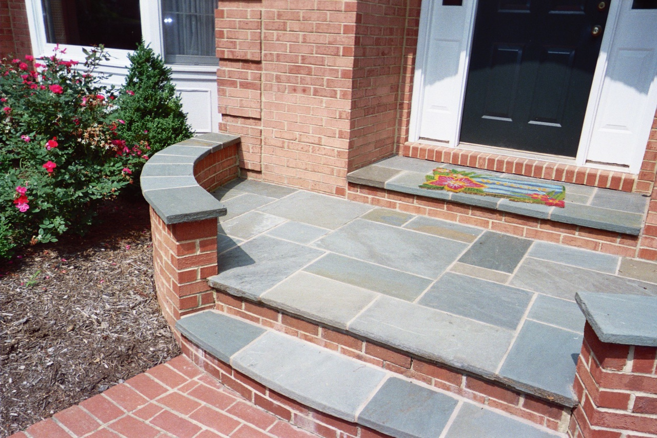 brick walkway, steps, and front porch with bluestone caps
