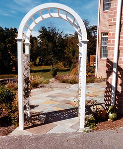 irregular bluestone patio and walkway with arbor
