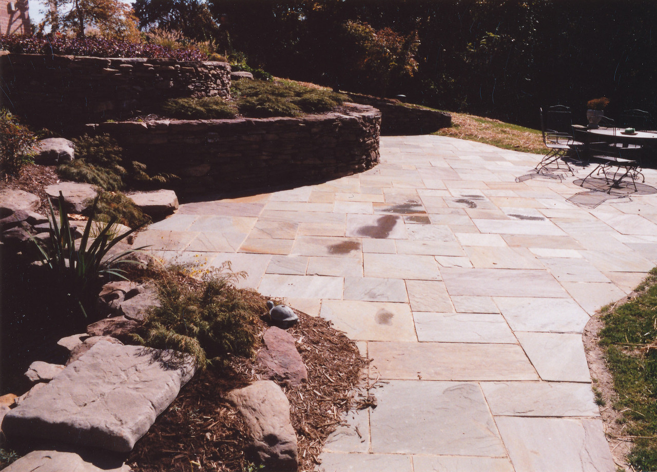 Bluestone patio with dry-stack sitting wall