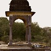 Tiger sleeping in a chattri or palace in Ranthambore tiger reserve