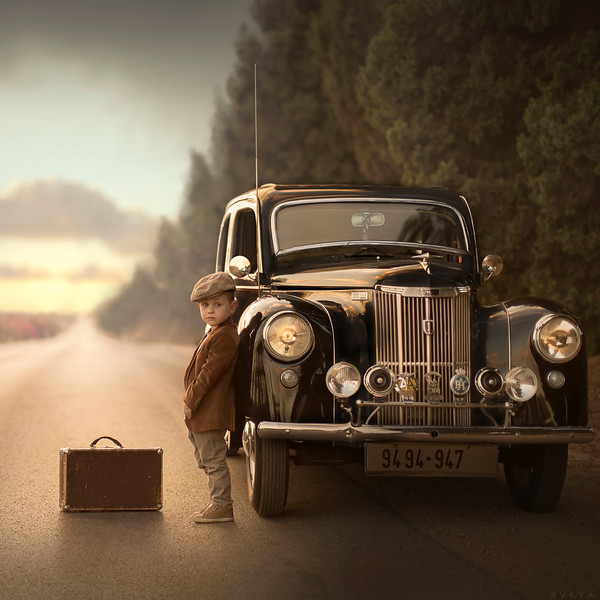 A boy with a retro car