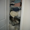 AFTER - months later. Linen closet in basement