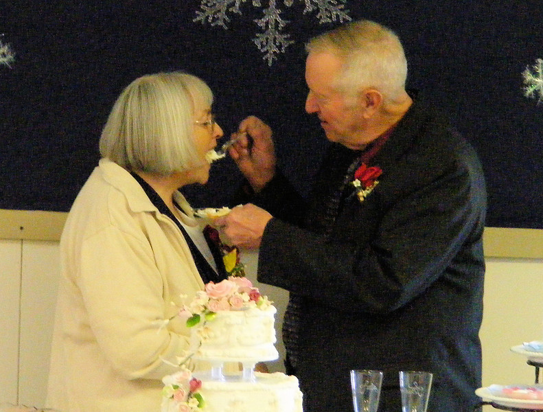 What Goes Around, Comes Around.<br /> He said something about not having a cake when they got married. They got one now.