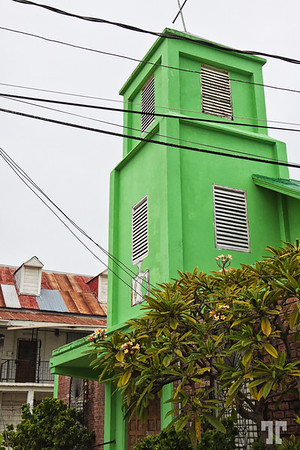 Green church tower in Belize city (xx)