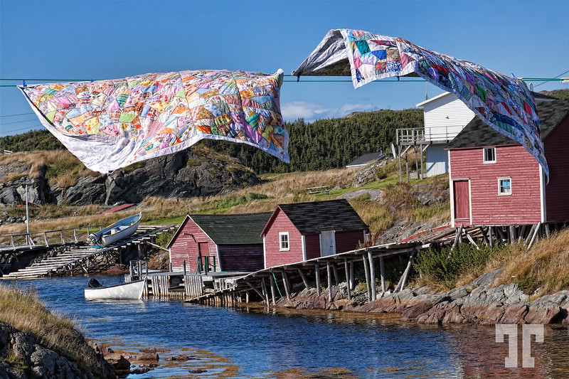 "Sept. 7, 2010  Change Islands, Newfoundland hanging quilts  I was looking for the opportunity of a shot like this for very long time.  Finally I gave up with the idea, thinking that the ""classic"" images showing hanging quilts in NFL were staged, so I'll never be able to get one.  - Yesterday, a miracle happened - a lady was just hanging these two out in the sun, and I was soooo ready for the shot :) Newfoundland, Canada, Atlantic Canada, maritimes"
