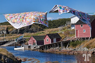 """Sept. 7, 2010  Change Islands, Newfoundland hanging quilts  I was looking for the opportunity of a shot like this for very long time.  Finally I gave up with the idea, thinking that the """"classic"""" images showing hanging quilts in NFL were staged, so I'll never be able to get one.  - Yesterday, a miracle happened - a lady was just hanging these two out in the sun, and I was soooo ready for the shot :) Newfoundland, Canada, Atlantic Canada, maritimes"""