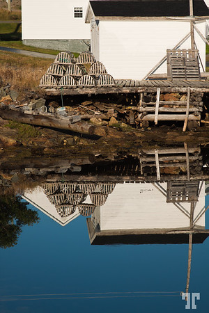Reflections of fisherman's shacks  in Newfoundland