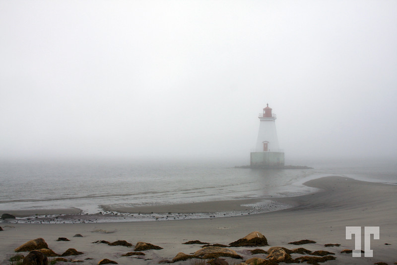 14 Sept 08<br /> <br /> Lighthouse in the fog - Sandy Point, Shelburne, Nova Scotia, Canada