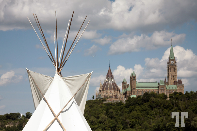 Teepee on the background of Canadian Parliament building. Scenic view from Victoria Island on Ottawa river