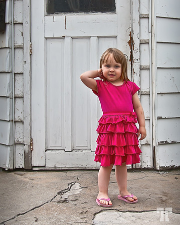 May 30, 2011  Contrast  - She's a French Canadian girl I found in an old neighborhood of Ottawa, while looking for interesting textures to photograph. She's 4 and likes to pose in front of the camera :)  * Best viewed in a large format for details.