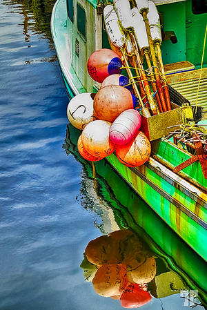 Green boat with buoys