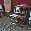 Street corner in Hamburg - chairs for smokers in front of a small restaurant  - February