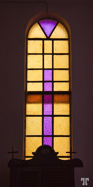 Stained glass church window in Las Flores, Flores Guatemala