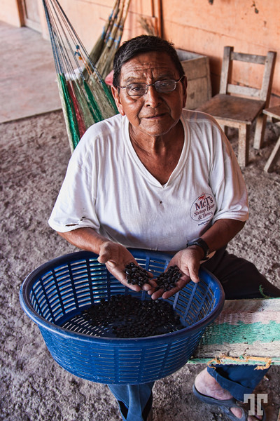 Man sorting black beans in a small village of Guatemala