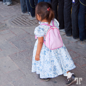 Little girl with a rose backpack