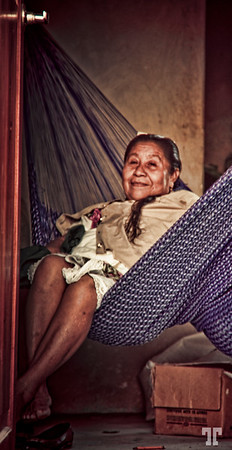 Evening relaxation<br /> 11 March 09<br /> <br /> I took this photo yesterday in a small Mexican village,<br /> though the open door. I asked and she gave me the permission.<br /> <br /> - Mexicans are definitely happy and friendly people by their nature.<br /> <br /> * Coba is one of the archeological places in Yucatan Peninsula, known for the Mayan ruins. Coba, Mexico