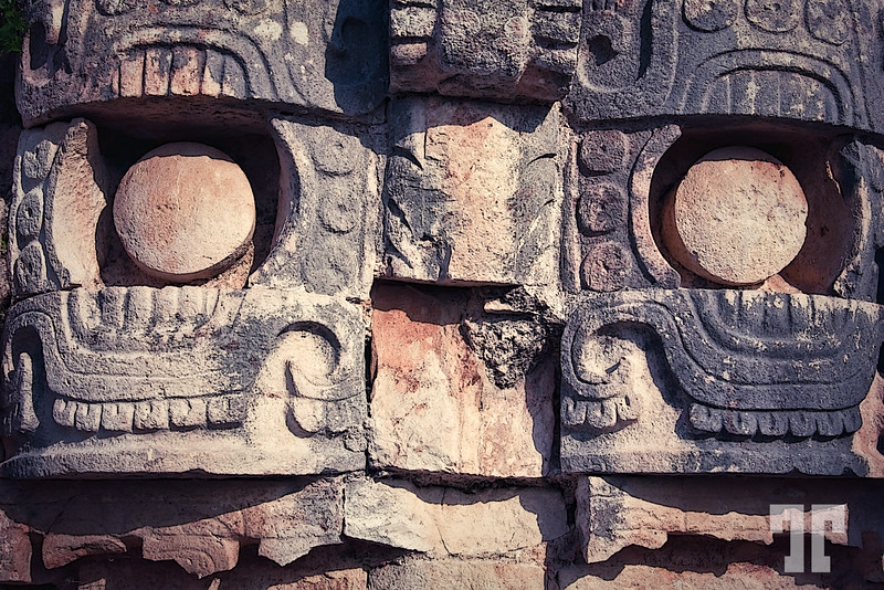 March 9, 2010  Wall of masks on the temple for the rain God called Chaac, at Kabah, Mayan site in Mexico  From wikipedia:  Kabah (also spelled Kabaah, Kabáh, Kahbah and Kaba) is a Maya archaeological site in the south-east of the Mexican state of Yucatán.  The name