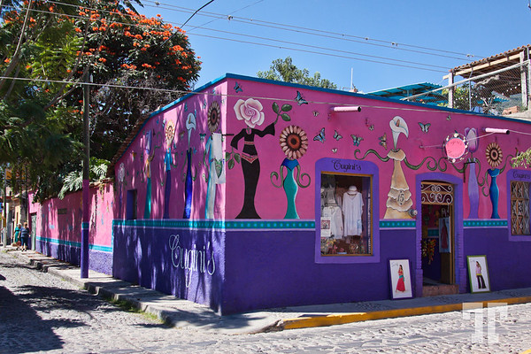 Pink decorated wall and store display in Ajijic, on Lake Chapala, Mexico