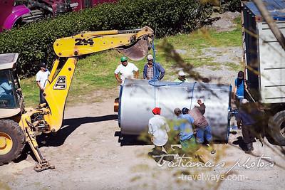Loading a huge coffee rosting bin at Finca Lerida, coffee farm in Panama