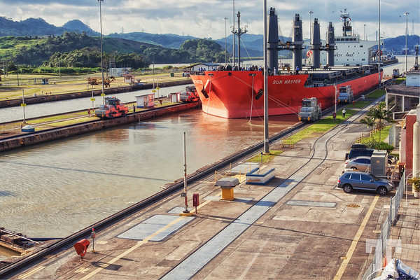 Red boat crossing Panama Canal