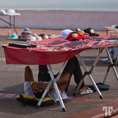 Indigenous souvenir vendors hiding from the heat of the sun - Panama Casco Viejo