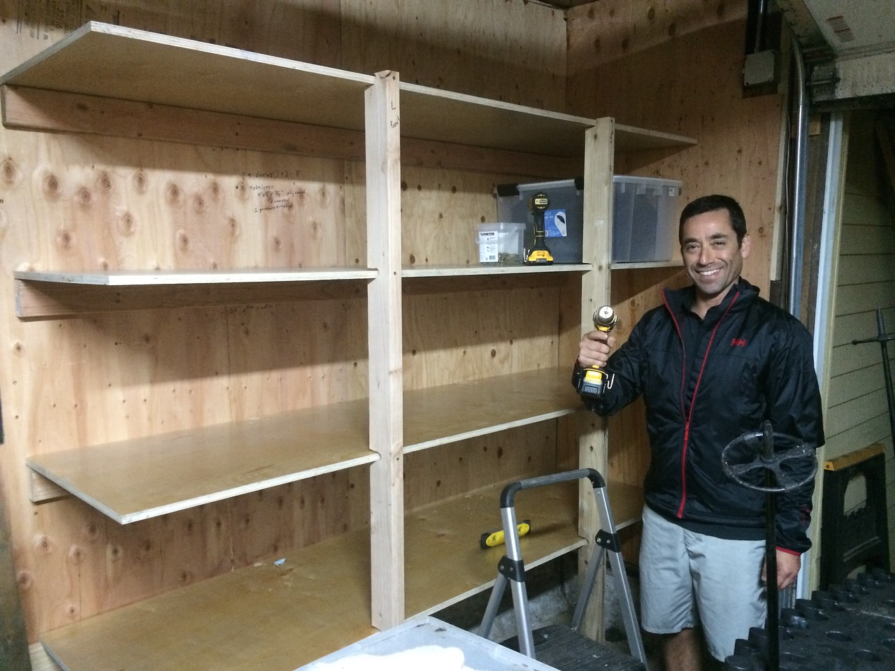 Custom 7' shelving installed along garage wall.