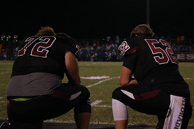 Photo by: Emma Dowd Athletes take knee during water break after half time.