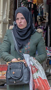 Palestinian woman shopping--she doesn't look particularly happy