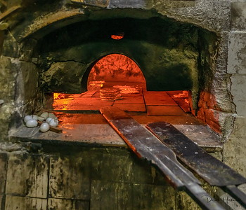 Cooking Pita in a stone oven