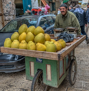 Merchant bringing produce into the market at Nablus in the West Bank