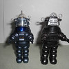 "New Hallmark Robby light-up, speaking ornament on the left. 1984 Masudaya 4.25"" wind-up Robby on right."