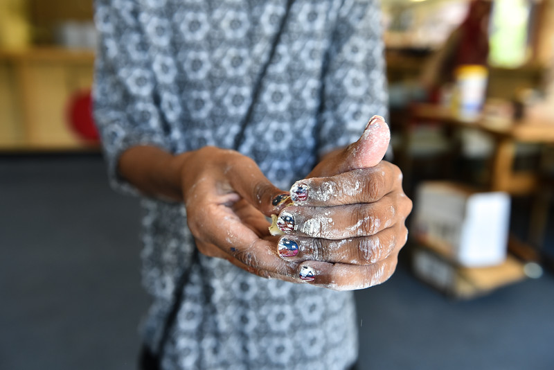 The hands of 9 yaer old Bareerah Khilat making a pinch pot at the Fitchburg Public Library on Monday.  SENTINEL & ENTERPRISE JEFF PORTER