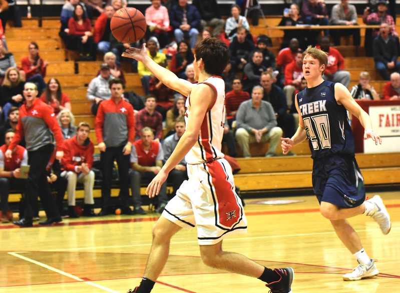 Fairview's Mark O'Neill throws a lob pass to teammate Jalen Page (not pictured) during the fourth quarter of the Knights game against Pine Creek in the first round of the Class 5A state tournament on Wednesday night at Fairview High School.