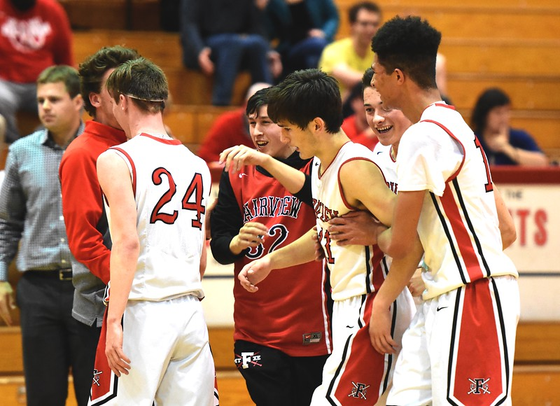 The Fairview basketball players congratulate sophomore Mark O'Neill on a critical defensive play just before the end of the third quarter during the first round of the Class 5A state tournament on Wednesday night at Fairview High School.