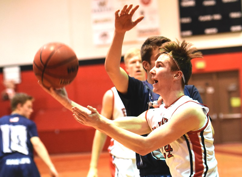Fairview's Mark Dolan tries to get off a shot while being fouled by a Pine Creek defender during the first round of the Class 5A state tournament on Wednesday night at Fairview High School.