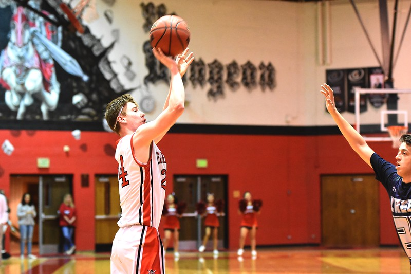 Fairview's Mark Dolan fires a 3-pointer during the first round of the Class 5A state tournament on Wednesday night at Fairview High School.