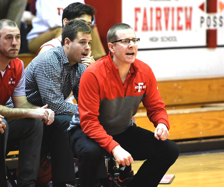 Fairview head coach Patrick Burke yells instructions to his players during the first round of the Class 5A state tournament on Wednesday night at Fairview High School.