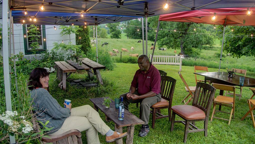 Sarah and Jim Jackson sharing some wine and humor.