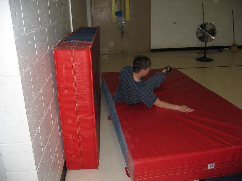 Alex R. practices his crash landings in the gym.