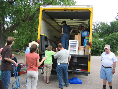 Unloading at our new home at Christ the King Catholic Church and Parish Hall in Porcupine, SD on the Pine Ridge Rez.