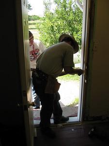 Replacing side door at St. Julia's.
