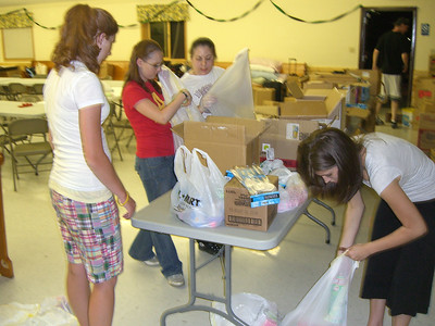 Packing bags for the big Give-Away on Sunday.