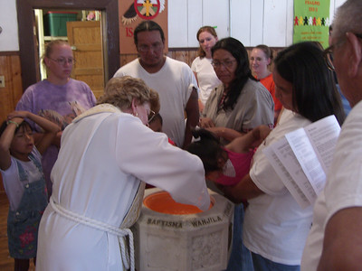Three children were baptized during the Sunday service, Judi also being honored as a Godmother.