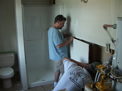 Over at Marlene's home - the plumbers finishing up the new bathroom.