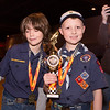 Corbin and Aiden pose with their first and second place trophies