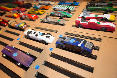 Entries in the Pinewood Derby are cued up for racing.