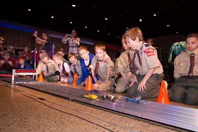 Evan (second from right) watches his car race to the finish line with other Webelow Scouts.